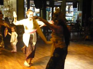 Lina trying to Balinese dance at Made's Warung, in Seminyak, Bali