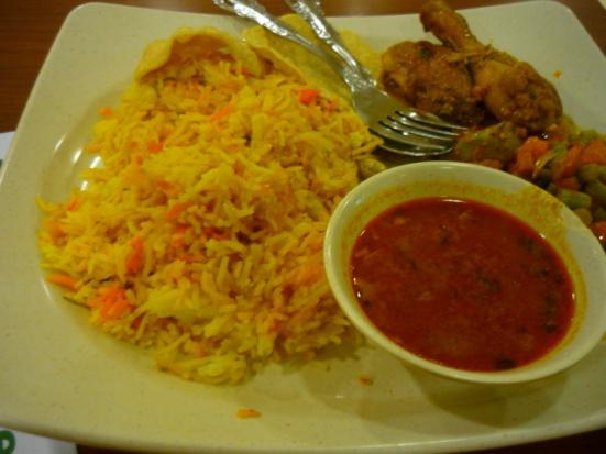 Eating a chicken briyani at a hawker centre