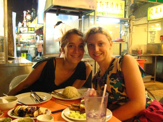 Lina and Pippa after eating Chicken Rice and Satay in street food market in Kuala Lumpur, Malaysia
