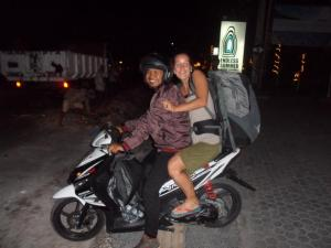 Lina on motorcycle with a lovely Balinese waiter