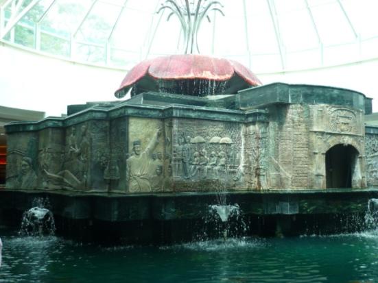 Pretty Chinese water fountain in Malaccan shopping mall in Malacca, Malaysia