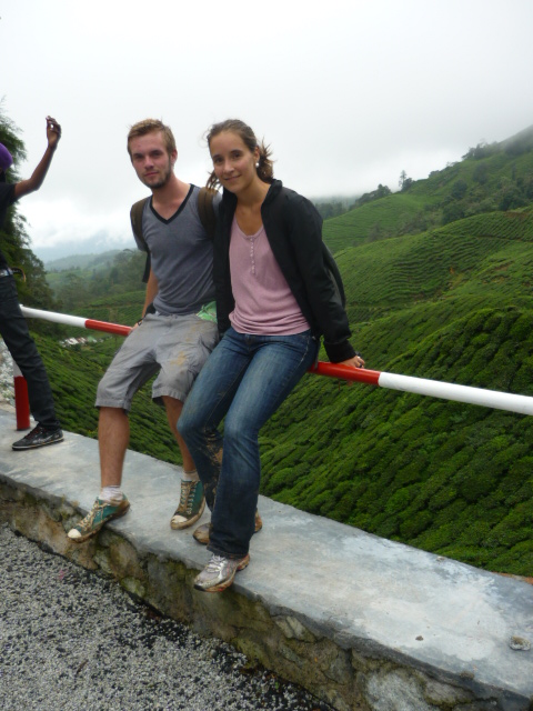 Christian and Lina posing at the top, next to Boh Tea Estate, in Cameron Highlands, Malaysia