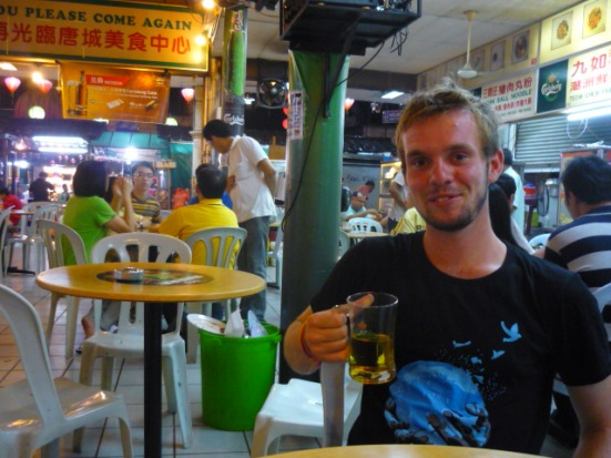 Christian... drinking nothing other than... beer in Hawker Centre in Chinatown, Kuala Lumpur, Malaysia