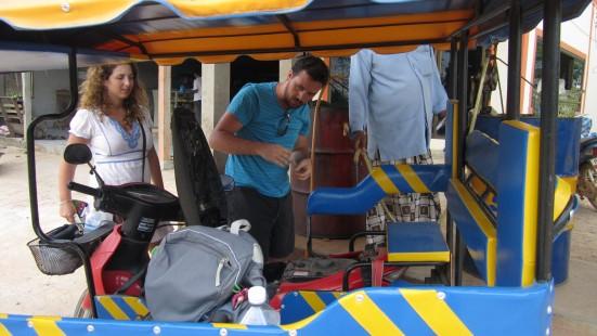 Mr Tuk Tuk putting petrol in our tuk-tuk in Koh Lanta, Thailand
