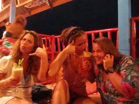 Mandy, Lili and Lina acting out the 'telephone' theme in Barracuda Bar, Koh Lanta, Thailand