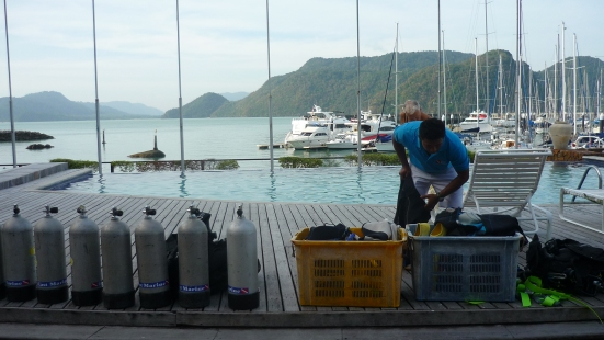 Instructor preparing equipment for our confined water dive, East Marine Dives, Langkawi, Malaysia