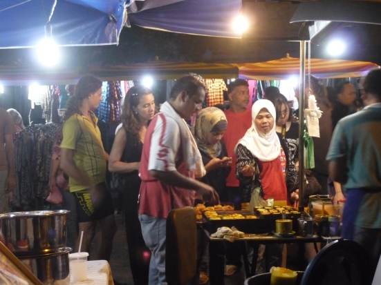 Lina queuing to purchase desert from street vendor at Kuah Night Market, Langkawi, Malaysia