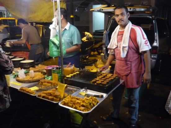 Incredible Coconut & Egg deserts served at street vendor in Kuah Night Market, Langkawi, Malaysia