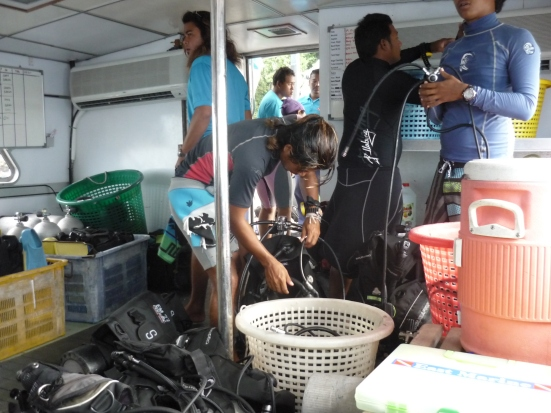 Instructors preparing equipment for dives at Pulau Payar off Langkawi, Malaysia