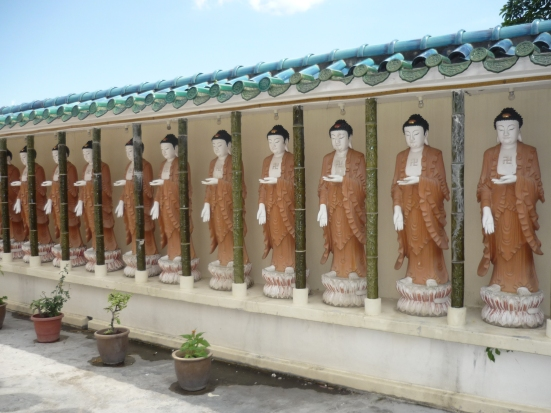 Young, standing Buddhas in Kek Lok Si Buddhist Temple in Penang, Malaysia