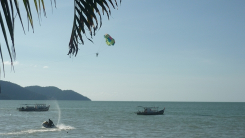 Watching enviously at tandem para-sailors on Batu Ferringhi in Penang, Malaysia (oh, how much I long to para-sail)