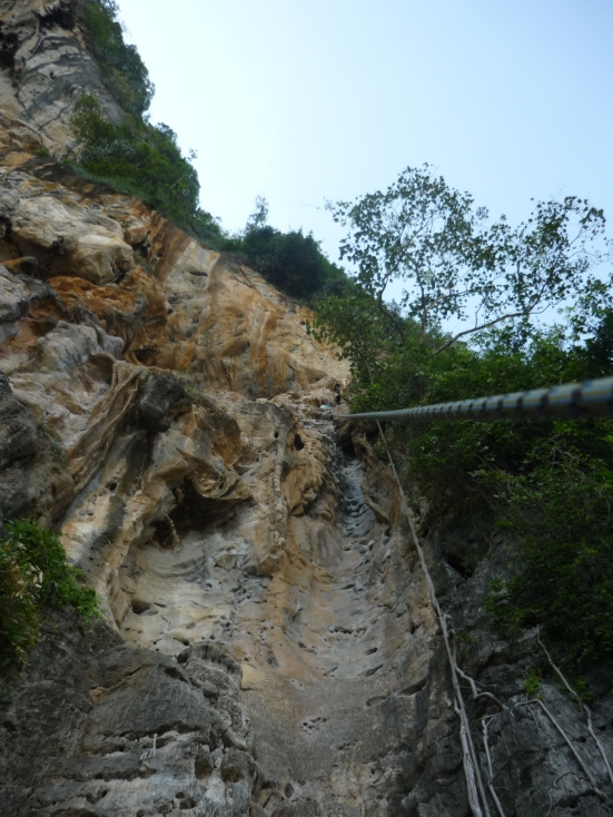 Somewhere at the top of the 'Groove Tube' is a bright blue speck - that's me! in Tonsai-Railay, Thailand