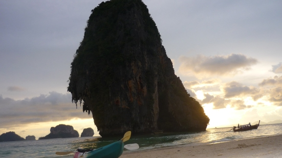 Stopping for lunch by kayak during sunset at scenic Phra-nang beach near Tonsai, Thailand