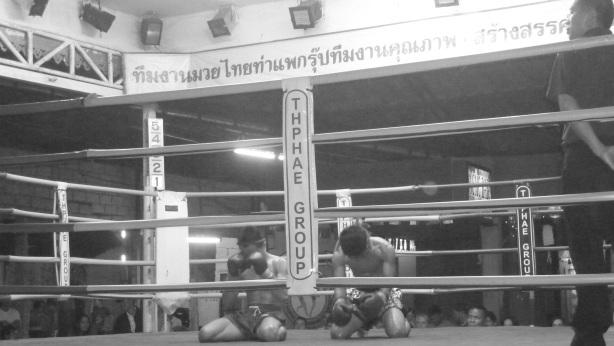 Muay Thai boxers at prayer before the fight in Chiang Mai, Thailand
