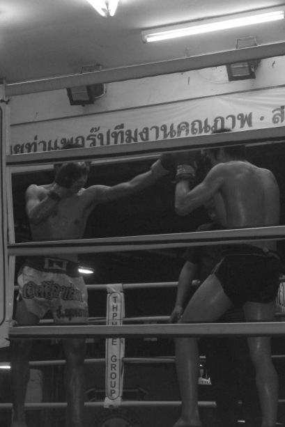 Punch to the face in Muay Thai boxing in Chiang Mai, Thailand