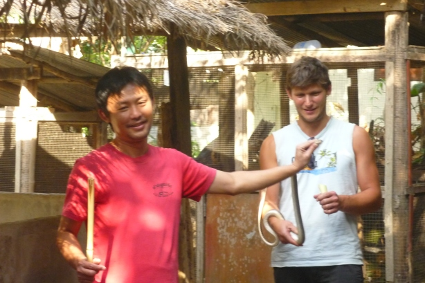 Nico holding a snake in Mae rim snake farm near Chiang Mai, Thailand