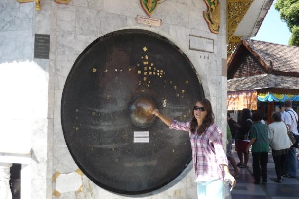 Lina having a go at the spiritual gong at Doi Suthep, Chiang Mai, Thailand