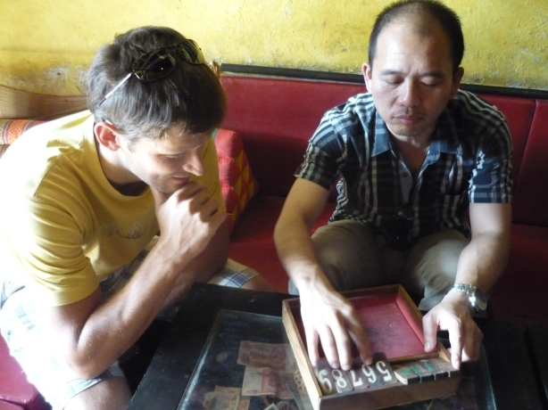 Nico and Chai (owner of Chang Chalaad) playing Jackpot in Chiang Mai, Thailand