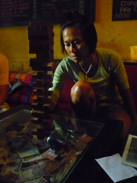Nok playing Jenga in Chang Chalaad, Chiang Mai, Thailand