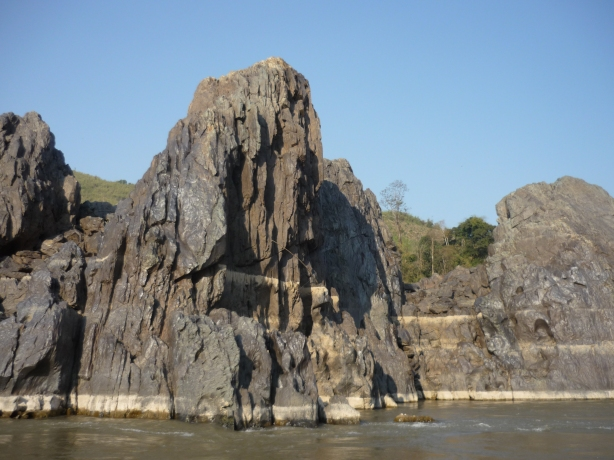 Dramatic rock formations along the Mekong River in Laos