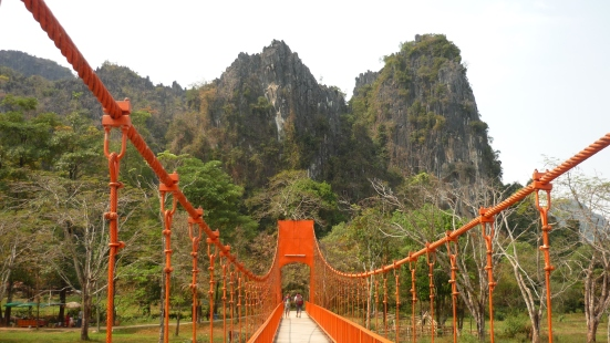 Bright red bridge en route to Vang Vieng cave in Laos