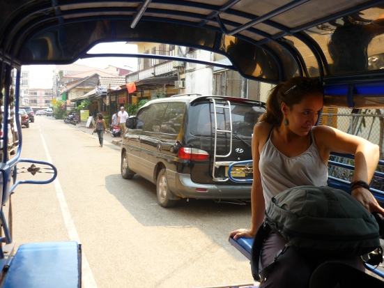 Lina in tuk-tuk to bus station in Vientiane, Laos