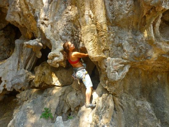 Lina climbing in Thakhek, Laos