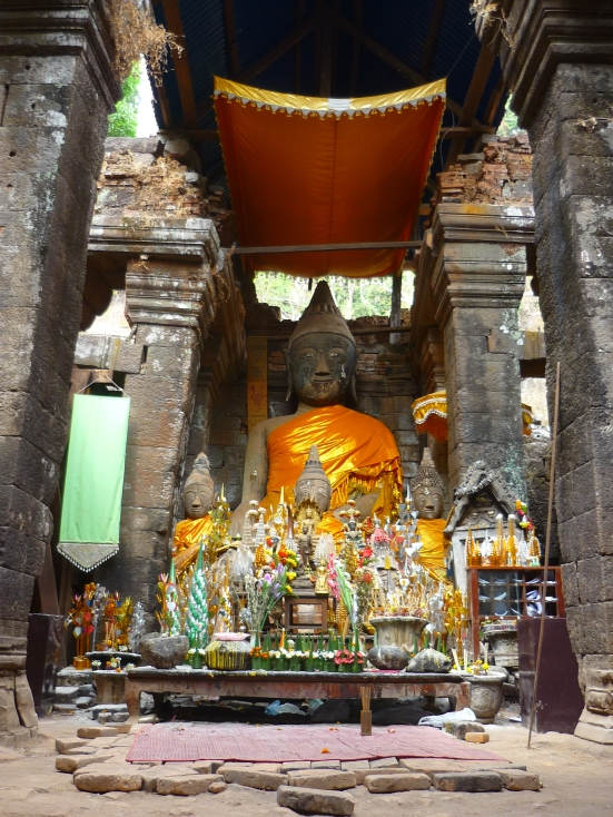 Vibrant Buddhist shrine inside the temple of Wat Phu Champasak in Laos