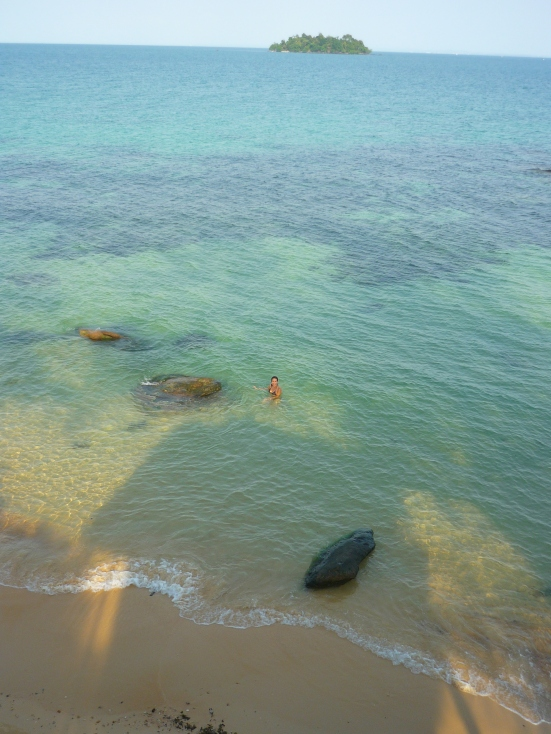 The speck of Lina swimming at our own beach in Koh Rong, Cambodia