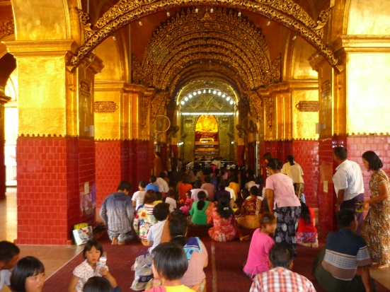 Locals during Buddhist prayer at Mandalay Temple in Myanmar (Burma)