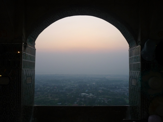 View from a window on Mandalay Hill: fog, smog and pollution on a hot and sunny day in Myanmar (Burma)