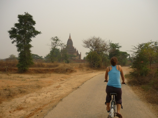 Lina cycling around Bagan to visit temples in Myanmar (Burma)