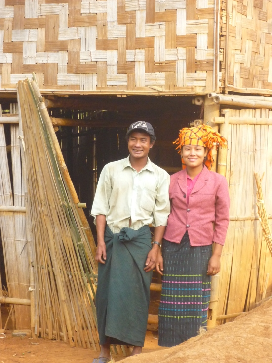 The lovely Pao newly-weds who hosted us in their new window-less, bamboo hut in Myanmar (Burma)