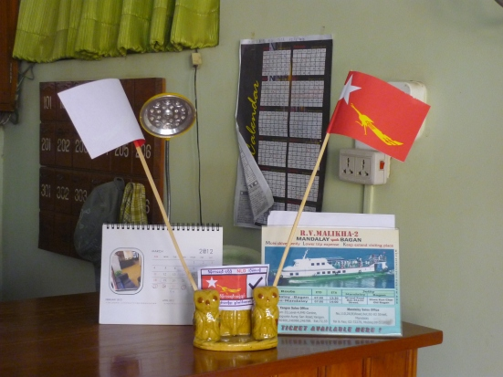 Hotel desk with National League for Democracy flags supporting Aung San Suu Kyi in Bagan during Myanmar's elections in April 2012