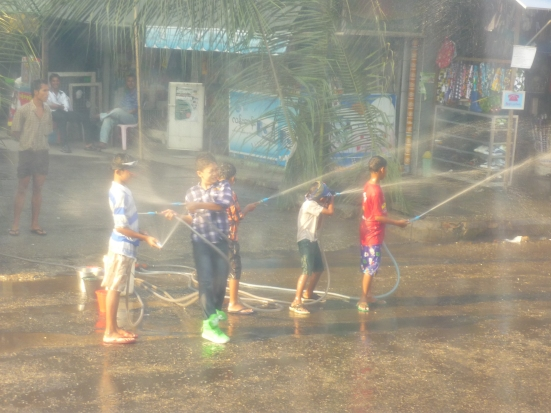 Children armed with running water in the streets of Yangoon during Myanmar's celebration of the annual Water Festival