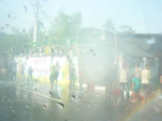 Misty and wet windows. Our taxi under water attack during Water Festival in Yangon, Myanmar